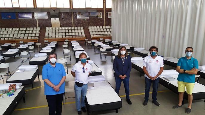 Onze voluntaris d'Open Arms per atendre els confinats al pavelló de Torres de Segre